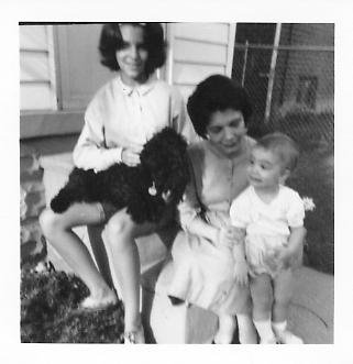 My sister, our dog Pom Pom Puff, my mom and me, circa 1963.