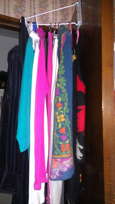 My mom's clothes, lined up in her closet, just as she left them.